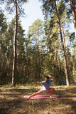 Man practicing martial arts outdoors in the forest Stock Image