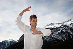 Man practicing martial arts Stock Photo