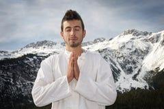 Man practicing martial arts. Man practicing Tai Chi, Yoga and Qi Gong Stock Photos