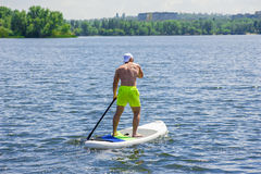 Man practicing paddle board 01 Stock Image