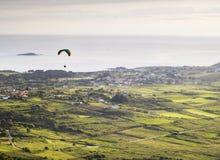 Man practicing paragliding at dusk Royalty Free Stock Photography