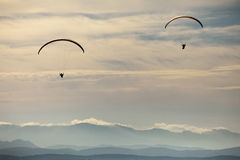 Man practicing paragliding extreme sport Stock Photography
