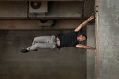Man practicing parkour in urban space. Stock Image