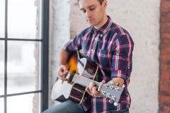 Man practicing in playing guitar focus on hand and chord Stock Photo
