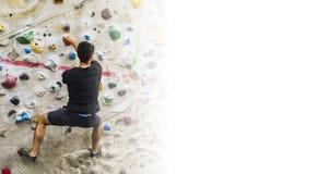 Man practicing rock climbing on artificial wall indoors. Active Royalty Free Stock Photos