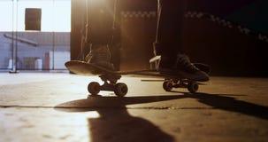 Man practicing skateboarding in skateboard arena 4k. Low section of man practicing skateboarding in skateboard arena 4k stock video footage