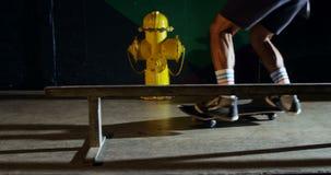 Man practicing skateboarding in skateboard arena 4k. Low section of man practicing skateboarding in skateboard arena 4k stock video