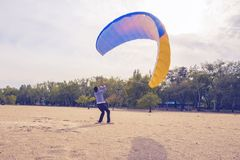 Man is practicing to control a paraglider Stock Photo