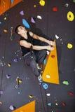 Man practicing top rope climbing in climbing gym Stock Photos