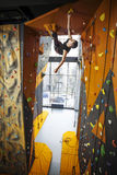 Man practicing top rope climbing in climbing gym Royalty Free Stock Photo