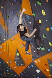 Man practicing top rope climbing in climbing gym Royalty Free Stock Photography