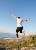 Man practicing trail running with a coastal landscape Royalty Free Stock Image
