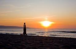 Man practicing Yoga. At Sunset Stock Photos