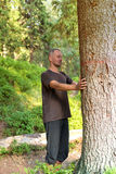 Man  is practicing yoga in forest Stock Photography
