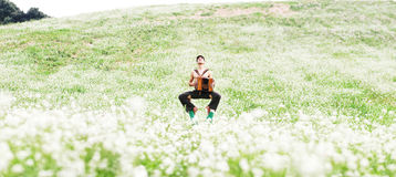Man practicing yoga in the green garden. With e yoga extension Stock Photo