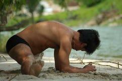 Man practicing yoga outdoors Royalty Free Stock Image