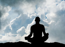 Man practicing yoga outdoors Royalty Free Stock Photography