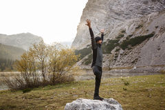 Man practicing yoga, performing a tree pose Royalty Free Stock Photography