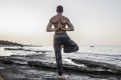 Man practicing yoga royalty free stock image
