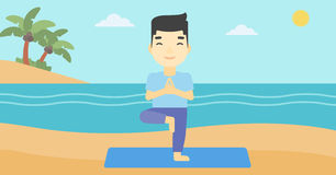 Man practicing yoga tree pose on the beach. Royalty Free Stock Photos