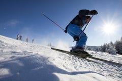 Man practising extreme ski. On sunny day stock image