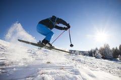 Man practising extreme ski. On sunny day royalty free stock image