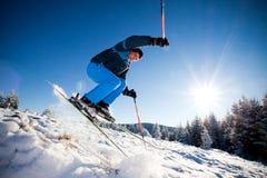 Man practising extreme ski. On sunny day stock photography