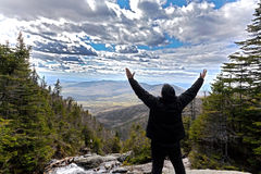Man in praise looking out from elevation on Mount Washinton via. Man in praise while  looking out from elevation on Mount Washinton via Ammonoosuc ravine trail Royalty Free Stock Image