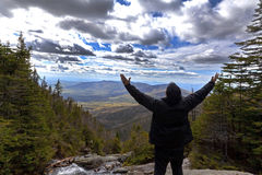 Man in praise looking out from elevation on Mount Washinton via. Man in praise while  looking out from elevation on Mount Washinton via Ammonoosuc ravine trail Stock Photography