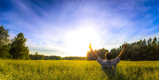 Man praising in field Stock Image