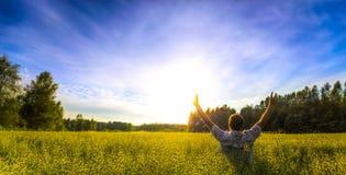 Man praising in field. Man praising his heart out in beautiful field Stock Image