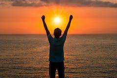 A Man Praising or Worshiping at Sunrise