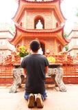 A Man pray in chua tran quoc Temple near Ho Tay Lake in Hanoi, V stock photo