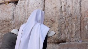 Man pray at the western wall stock footage