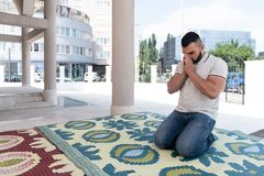 Man Prayer at Mosque. Muslim Man Making Traditional Prayer to God Allah in the Mosque royalty free stock images