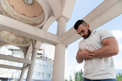 Man Prayer at Mosque. Muslim Man Making Traditional Prayer to God Allah in the Mosque stock photo