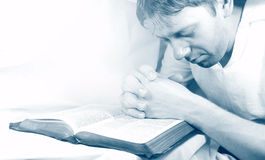 Man Praying. With holy bible (monochrome Royalty Free Stock Image