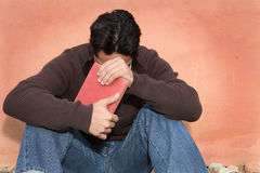 Man praying. Christian man holding, bible while praying stock photography