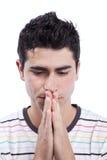 Man praying. Young man praying (isolated on white royalty free stock photos