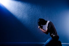 Man praying. One man praying in the room royalty free stock photography