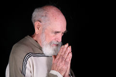 Man praying. To God isolated on black background Royalty Free Stock Photos