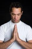 Man Praying. Young african american man praying stock photography