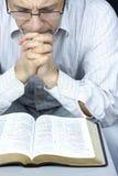 Man praying. Adult man with glasses praying royalty free stock photos