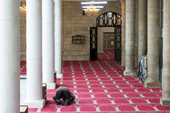 A man praying in the Al Husseini Mosque in Amman, Jordan Stock Photos