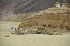 Man praying alone in the desert Royalty Free Stock Photo