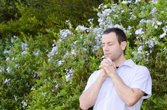 Man praying alone outside. Stock Images