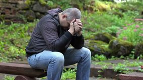 Man praying on bench with the rosary stock video footage