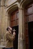 Man praying in church holding prayer beads Royalty Free Stock Images