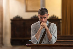 Man praying in the Church Stock Photos