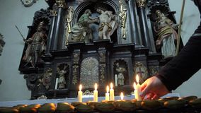 A man praying at the church to put candles. stock video footage